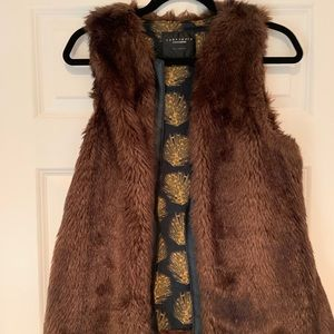 Brown fur vest with leather trim